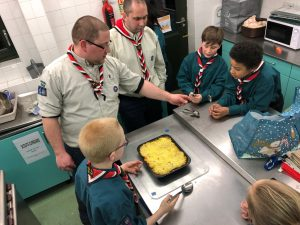 Sparks and Coxswain inspecting the Scouts' cooking efforts
